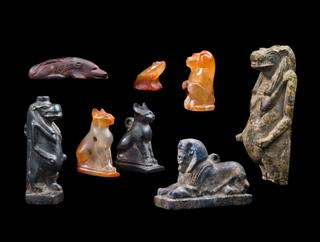 image Group of Eight Hardstone Amulets